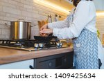 woman fry on pan kitchen view.... | Shutterstock . vector #1409425634
