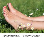 A Pair Of Lady's Feet Crossed...