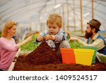 little biologist. little biologist work with soil. little biologist in greenhouse. little biologist child planting flowers