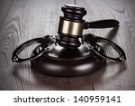 Handcuffs And Judge Gavel On...