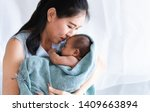 selective focus asian mother... | Shutterstock . vector #1409663894