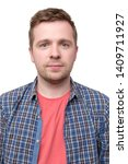 Stock photo passport picture of a guy in a checked shirt and pink t shirt 1409711927