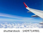 sky wings and white clouds...   Shutterstock . vector #1409714981