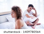 Portrait of newlywed have a fight in bed. The couple having difficulties in relationship. Wife always sulking & husband get angry easily. He has problem with erection too. Domestic violence concept.