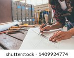 carpenter working with... | Shutterstock . vector #1409924774