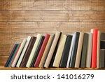 old books on a wooden shelf. no ... | Shutterstock . vector #141016279