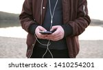 young handsome man holds mobile ... | Shutterstock . vector #1410254201