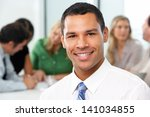 portrait of businessman sitting ... | Shutterstock . vector #141034855
