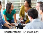Stock photo bible group reading together 141036124