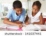 two children doing homework... | Shutterstock . vector #141037441