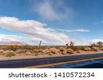 lonely dessert road and rainbow ... | Shutterstock . vector #1410572234