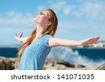 beautiful woman celebrating the ... | Shutterstock . vector #141071035