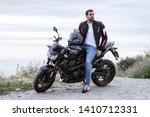 Young Man Biker With His Black...