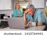 Small photo of Older senior married couple in distress, concerned over mortgage, finances, financial earnings, debt