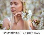 girl holding a branch of cherry ... | Shutterstock . vector #1410944627