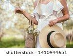 girl in white dress holding hat ... | Shutterstock . vector #1410944651