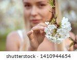 girl holding a branch of cherry ... | Shutterstock . vector #1410944654