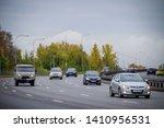 cars driving on asphalt road. a ... | Shutterstock . vector #1410956531