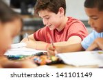 pupils studying at desks in... | Shutterstock . vector #141101149