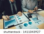 managers are using tablets to... | Shutterstock . vector #1411043927