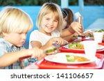 elementary pupils enjoying... | Shutterstock . vector #141106657