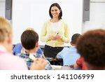 Teacher Standing In Front Of...