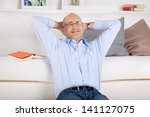 smiling man relaxing and... | Shutterstock . vector #141127075