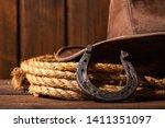 an old horseshoe lies next to a ... | Shutterstock . vector #1411351097