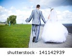 the bride and groom are on the... | Shutterstock . vector #141142939