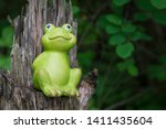 Ceramic Statue Of A Frog On A...