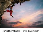 Athletic Woman Climbing On...