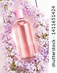 pink bottle of women's perfume...   Shutterstock . vector #1411651424