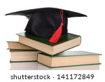 grad hat with books isolated on ... | Shutterstock . vector #141172849