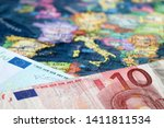 euro banknotes on the map of...   Shutterstock . vector #1411811534