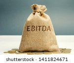 Small photo of Money bag with the word Ebitda. Earnings before interest, taxes, depreciation and amortization. Financial result of the company. Cash flow estimate. Financial performance ratio. Pretax profit.