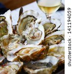 image of fresh oysters with... | Shutterstock . vector #141194059