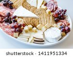White Platter Of Cheese And...