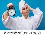 photo of woman with alarm clock | Shutterstock . vector #1412175794