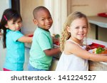 Stock photo elementary pupils collecting healthy lunch in cafeteria 141224527