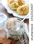 Stock photo herring marinated in mustard pieces in a glass jar selective focus 1412313437