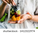 A Glass Jar With A Salad Of...
