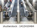 Escalator. Stairs. People Go O...