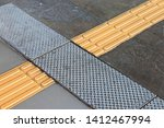 bright yellow tactile paving ... | Shutterstock . vector #1412467994