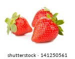 three fresh strawberries... | Shutterstock . vector #141250561