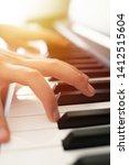 Stock photo piano keys and playing piano 1412515604