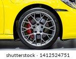 Nonthaburi , Thailand - April 3, 2019 : close up wheel and disc brake of Porsche 911 Carrera S super sports car presented in motor show Thailand . - stock photo