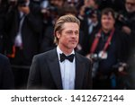"Small photo of CANNES, FRANCE - MAY 21, 2019: Brad Pitt attends the screening of ""Once Upon A Time In Hollywood"" during the 72nd annual Cannes Film Festival"