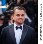 "Small photo of CANNES, FRANCE - MAY 21, 2019: Leonardo Di Caprio attends the red carpet before the screening of ""Once Upon A Time In Hollywood"" during the 72nd annual Cannes Film Festival"