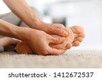 Man Hands Giving Foot Massage...