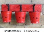 Three Fire Buckets Hanging On ...